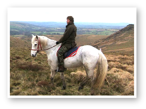 David Young artist riding Thomas on Tavy Cleave , Dartmoor